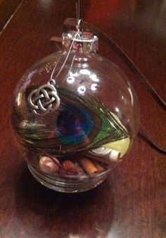 My Yule witch ball... Hanging in the picture window as a blessing on my home :)