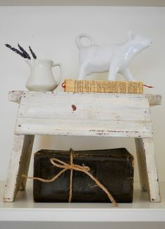 I have a collection of cow creamers.  I need the milking stool for a vignette :) (from The Grower's Daughter)