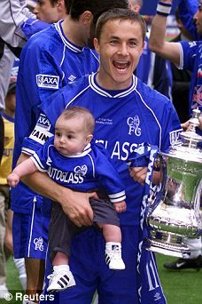 Chelsea's Dennis Wise holds Henry and the FA Cup in 2000,  Read more: http://www.dailymail.co.uk/sport/article-1296032/PICTURE-SPECIAL-From-Nursery-End-Crucible-creche-Youre-daddy.html#ixzz2XSAiIk8s Follow us: @MailOnline on Twitter | DailyMail on Facebook Chelsea Legend