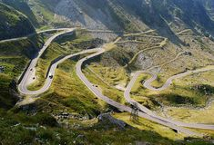 The Transfagarasan mountain road or national road is the second-highest paved road in Romania, and considered by some to be the most dram. Road Trip, Dangerous Roads, National Road, Destination Voyage, Largest Countries, Destinations, Places To See, Bali, Beautiful Places