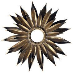 A Large-Scaled and Vibrant French 1940's Gilt-Tole Foliate Starburst Convex Mirror | From a unique collection of antique and modern sunburst mirrors at http://www.1stdibs.com/furniture/mirrors/sunburst-mirrors/