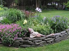 Image from http://oaktreelife.com/wp-content/uploads/2015/01/garden-divine-picture-of-garden-decoration-using-round-grey-stone-veneer-garden-bed-including-round-grey-stone-garden-border-and-grass-garden-flooring-good-looking-garden-landscaping-decoration-with-v.jpg.