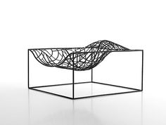 Ad hoc lounge chair by Jean-Marie Massaud. A chair and a piece of art, what more can one ask for?