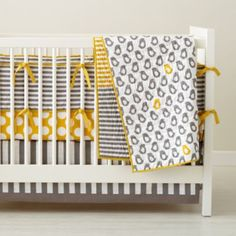 """No a Peep Crib Bedding. When we hatched the idea for this modern baby bedding we thought, """"Wouldn't it be great if it could mix colorful stripes and dots with a sweet, simple baby chick print?"""" Then we thought, """"It should have four coordinating fitted sheets and a reversible skirt."""" And then we thought, """"What if it could also guarantee parents a night of uninterrupted sleep?"""" Well, two out of three isn't bad."""
