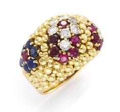 Van Cleef & Arpels. A Gold, Diamond, Sapphire and Ruby Dome Ring, circa 1960. Available at FD.   www.fd-inspired.com