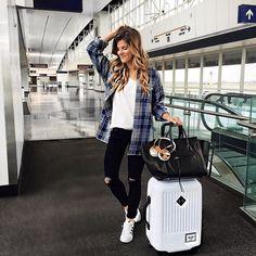 White t-shirt+blue plaid shirt+black ripped skinny jeans+white sneakers+black handbag+white suitcase. Fall Travel Outfit 2016