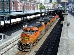 American Freight Train BNSF loco No. 4048 and another loco double-head a freight train at King Street station, Seattle.
