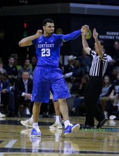 Kentucky Wildcats guard Jamal Murray (23) reacted by shooting an arrow after draining a three pointer to give him 21 for the half.