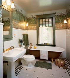 A frieze surmounts a tile wainscot  in a Victorian Revival bathroom; 'Kingfisher' frieze, 'Lilypad Border,' and 'Fish Border' were client-commissioned and can be special ordered from Bradbury & Bradbury. (Photo: Linda Svendsen)