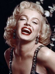 Marilyn's sexy white-blonde curls personified glamour in the 1950s, and have since been imitated by many celebrities including Madonna, Anna Nicole Smith, Gwen Stefani, Christina Aguilera, and Scarlett Johansson.