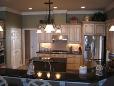 Love the colors for the kitchen.the sage green walls with the ivory cabinets! I already have this sage color in my dining room and love it Beige Kitchen Cabinets, Ivory Cabinets, Green Kitchen, New Kitchen, Kitchen Ideas, Benjamin Moore, Sage Green Walls, Glazed Walls, Buying A New Home
