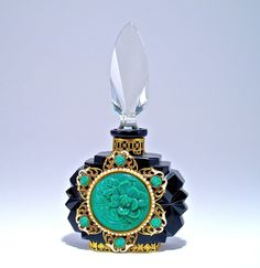 c1930 Czechoslovakian perfume bottle, black crystal, clear faceted stopper, dauber, enameled gilt filigree metalwork, opaque green jewels. Czechoslovakia in metal, MIC in lines and oval. 6 in.