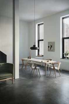 Minimalistic and simple dining room that does not take over the room. Wooden dining room inspiration.