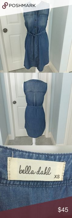 """Bella Dahl Sleeveless Denim Shirt Dress Bella Dahl sleeveless denim shirt dress. Purchased at Neiman Marcus. Soft, lightweight fabric is 100% Tencel. Tie belt. Uneven hem is slightly higher on sides. Measures approx 17"""" armpit to armpit and 38"""" from top of shoulder to lowest point of back hem. Excellent condition! Bella Dahl Dresses"""