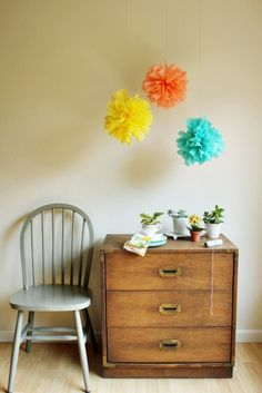 DIY crepe paper poms by Hank + Hunt for The Sweetest Occasion - would look cute in a toddler room!