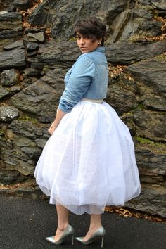 Nadia Aboulhosn. I love the poofy skirt with the denim shirt! Could do it with a sparkly tank and cropped denim jacket too