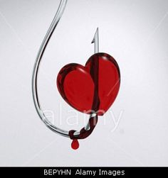 bloody heart on a hook    © Mikhail Tolstoy / Alamy