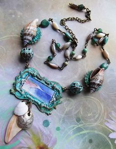 """Montauk Memories, Sentimental Journey. Verdigris patinas and brass from B'Sues, beach shells, turquoise, beach glass beads and MOP, Watercolor of Montauk beaches by me, covered with Mica and adorned with tiny seed pearls also from B'Sues. Length 20' + 4"""" extender"""