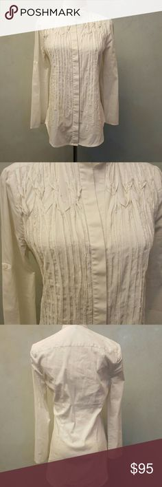 BCBG MAXAZRIA white button down Bcbg maxazria white detailed button down. 3/4 sleeve slightly longer in the back . In great condition. BCBGMaxAzria Tops Button Down Shirts