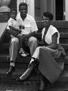 On this day in Jackie Robinson broke MLB​'s color barrier. 📷Nina Leen, [Brooklyn Dodger baseball star Jackie Robinson holding his young son Jackie Jr. on his lap as he sits with his wife Rachel on front steps of their home], 1949 My Black Is Beautiful, Black Love, Black And White, Beautiful Family, Beautiful Wife, Black Man, American Women, American Story, American Art