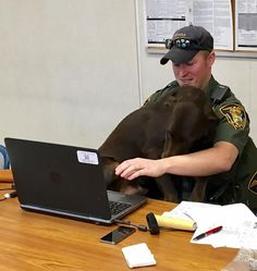 Conservation Officer Levi Knach and Kenobi, his faithful K-9, recently sat to pose for an official photo shoot - but, instead of being professional, the doggie took it as a perfect opportunity for some serious PDA. Now the pictures of a pooch kissing his partner are going viral. And we can't really blame officer Knach for breaking into a smile - it would be impossible to have a poker face when facing snuggles like these. You can tell it's true love...