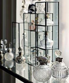 display of vintage perfume bottles