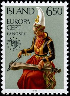 Icelandic stamp of a woman in traditional costume playing a Langspil, a traditional Icelandic drone zither.