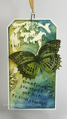 Background on this tag is created with Distress Inks, Tim Holtz Mask and Darkroom Door stamps. The butterfly is stamped and heat embossed on vellum. I used a mini paper clip from Tim Holtz at the top. Detail photos are on my blog HERE