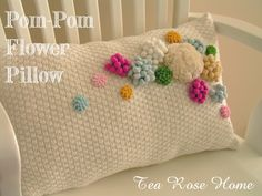 I actually kept my most favorite pom-pom flower project for last...yes, a pillow. I found a cotton sweater at the thrift shop for very cheap (I think it was ...