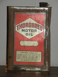 A Thorobred 5 Gallon motor oil can
