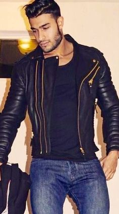 A regular guy in jeans and leather jacket.