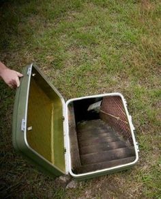 Staircase inside a suitcase. Unknown artist