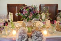Shades of Lavender the Bridal Bouquet took pride of place on the top table