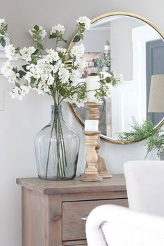 30 Farmhouse spring decorating ideas to make your home come alive Sometimes it can be hard to find pretty farmhouse decor ideas. Here are 30 of the best farmhouse Spring decor ideas for your home W… Vases Decor, Table Decorations, Table Centerpieces For Home, Everyday Centerpiece, Tall Vase Decor, Floor Vase Decor, Dining Room Centerpiece, Spring Decorations, Living Room Decor