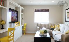 Yellow and grey family room.  This would be great for the bonus room. Study and tv.