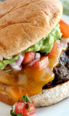 Mexican Burgers ~ the guacamole adds that layer of creamy goodness!  And the fresh pico de gallo is crisp and zesty amongst the guacamole!