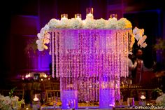 Crystal table decor for Sindhi Wedding Reception at the The Westin Diplomat Resort in Ft. Lauderdale. Center piece, gold table setting. Destination Wedding by PhotosMadeEz. Fusion Wedding featured by Maharani Weddings.