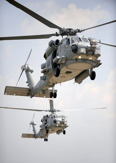 Two multi-mission MH-60R Seahawk helicopters fly in tandem during section landings at Naval Air Station Jacksonville, Florida. The new Seahawk variant has many improvements, such as the glass cockpit, improved mission systems, new sensors and advanced avionics. (U.S. Navy photo by Mass Communication Specialist 2nd Class Shannon Renfroe/Released)