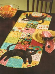 Table runner that has cats that look like my 2 black cats.