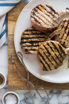 Mustard Crusted Pork Chops: 4 (10-12 ounce) bone-in pork chops, preferably frenched, 1/2 cup whole grain mustard, 2 1/2 tablespoons Dijon mustard, 2 garlic cloves, minced, 3 tablespoons extra virgin olive oil, Salt and pepper to taste