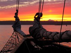5 am anchor watch aboard the Schooner Adventuress in Griffin Bay off San Juan Island. Mount Baker with Lopez Island in the foreground.-   Photo Credit- Dan Adams