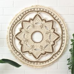 This intricately knotted wall hanging was carefully created over many hours and weeks, using the highest quality natural cotton and jute cord. With its symmetry and lotus flower motif, it will br. Macrame Mirror, Macrame Art, Macrame Design, Macrame Projects, Macrame Knots, Macrame Wall Hanging Patterns, Macrame Patterns, Crochet Patron, Crochet Decoration
