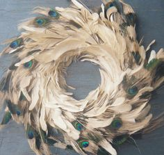 I'm not entirely sure where I'd put this.but I love wreaths and I love peacock feathers.and I apparently love peacock feather wreaths Peacock Wreath, Feather Wreath, Peacock Decor, Twig Wreath, Feather Crafts, Peacock Theme, Peacock Feathers, Acorn Wreath, Feather Art