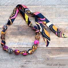 Hand knotted, fabric covered bead necklace