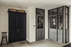 Glazed metal and wooden screens leading into a pantry and scullery in the Greenwich Park Kitchen. Glazed screen by Plain English. Walk in cupboard. Hallway Cupboards, Grey Cupboards, Flat Interior, Kitchen Interior, Kitchen Design, Plain English Kitchen, English Kitchens, Kitchen Larder, Larder Cupboard