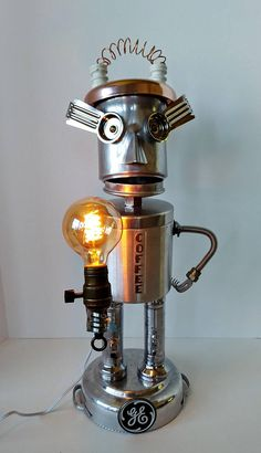 Found Object Robot Assemblage - Coffee Robot - CoffeeBot - This is a Powerhouse Bot, and is a custom tribute to the old GE Powerhouse Plant in Ontario that is being turned into a Balzacs Coffee Shop. (Live in the Toronto area? check them out!) He/She stands 25 inches tall and holds a Vintage style 25 watt Edison bulb.  I can make you one similar to this, contact me