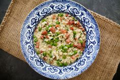A classic Italian comfort food of rice with peas and chunks of ham.
