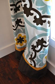 Curtains made from clearance Target tablecloth, with extra fabric added at the bottom for more length. So cute!
