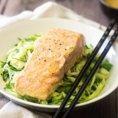 Zucchini noodles are topped with salmon in a SUPER easy, 3-ingredient coconut curry sauce for a light and healthy meal that feels fancy!
