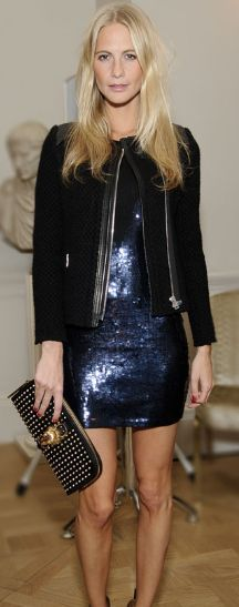Poppy Delevingne- sapphire sequins w/a black jacket & gold studded clutch